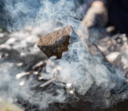 White thick smoke from smoldering firewood close-up. White thick smoke from smoldering firewood Royalty Free Stock Photography