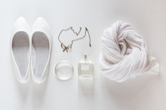 White things, shoes, scarf, perfumes and jewelry Stock Images