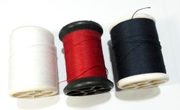 White thread, red, black, White background royalty free stock images