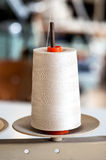 White thread roll on a stand for sewing Stock Images