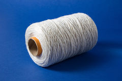 White thread  on white background. Rope, wool, knitting homemade handmade object. Royalty Free Stock Photos