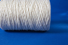 White thread  on white background. Rope, wool, knitting homemade handmade object. White thread  on white background. Rope, wool, knitting homemade handmade Stock Photography