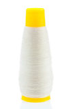 White thread on yellow bobbin Royalty Free Stock Images