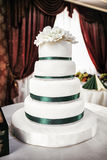 White tiered wedding cake Royalty Free Stock Images