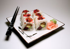White Tiger Roll. On plate with black chopsticks Royalty Free Stock Images