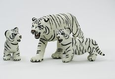 White Tigress Figurine Protecting her Two Cubs stock images