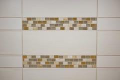 White Tile & Earth Tone Trim. White tile with earth tone colored trim detail stock photos
