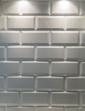 White tile. Illuminated by two lamps Stock Photo