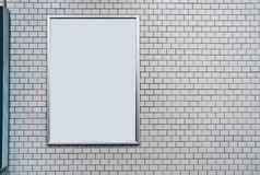 White tile wall with blank board. Mock up with copyspace. May be used ford graphic design stock photography