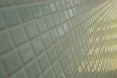 White Tiled Wall. Close up view of a white tiled wall with natural light reflections Stock Photography