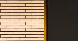 A white tiled wall with orange stripes and gray area royalty free stock photography