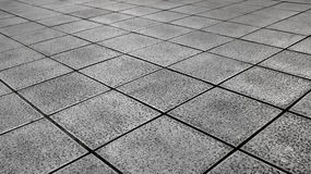 White Tiles ground in black and white Royalty Free Stock Images
