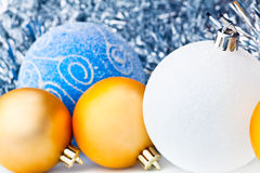 White tinsel and christmas balls Royalty Free Stock Photos