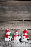 White tinsel and toy snowmen Stock Photos