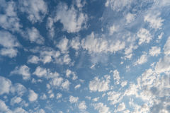White tiny clouds in blue sky background Stock Image