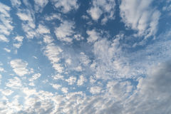 White tiny clouds in blue sky background Stock Images
