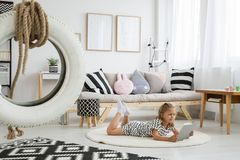 Cute girly scandi room. White tire on line above black and white patterned carpet in cute girly scandi room Stock Images