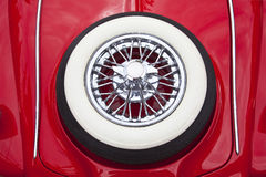 White tire on red car trunk Royalty Free Stock Photo