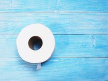 White Tissue paper on wooden blue background royalty free stock photo