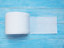 White Tissue paper on wooden blue background stock image