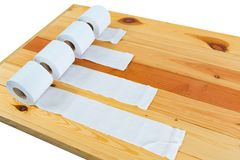 White tissues paper or toilet paper on wooden table. Royalty Free Stock Image