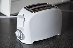 White toaster on the kitchen table. Household equipment Royalty Free Stock Image