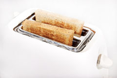 White toaster and wholewheat bread Royalty Free Stock Photos