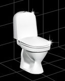White toilet. On a black tile with a gleam Stock Photo