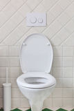 White toilet. In a bathroom royalty free stock image
