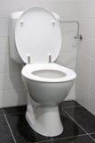 White toilet. Clean and white toilet in a bathroom stock photo