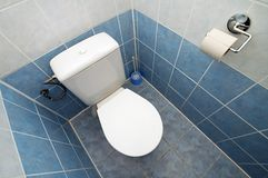Toilet in tiled bathroom Stock Photography