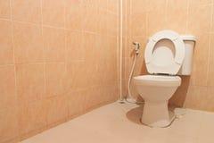 White toilet bowl in  bathroom Stock Photography