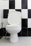 White toilet bowl in the bathroom Royalty Free Stock Image