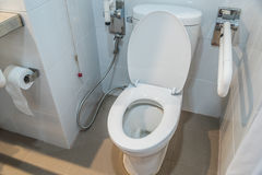 White toilet bowl in a bathroom asia Royalty Free Stock Photography