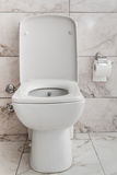 White Toilet Bowl in a Bathroom Royalty Free Stock Image