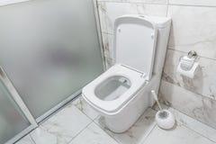 White Toilet Bowl in a Bathroom Royalty Free Stock Photo