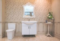 White toilet bowl in the bathroom with shower tiles and comfortable royalty free stock images