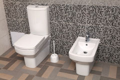 White toilet bowl and bidet in wc Stock Images