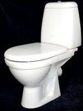 White toilet bowl  on black background Royalty Free Stock Image