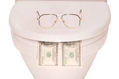 White toilet bowl glasses and money (Clipping path). Points on the lid of the toilet and money isolated with path Royalty Free Stock Photos