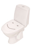 White toilet bowl and thumbtacks (Clipping path). Thumbtacks in the form of a smiley on the toilet bowl. Clipping path inside Stock Image