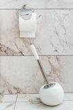 White Toilet Brush and Paper in a Bathroom Stock Image
