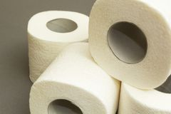 White toilet paper on a gray background royalty free stock photos