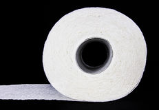 White toilet paper roll. Isolated on black background Royalty Free Stock Images