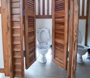White toilet in teak rest room stock photo