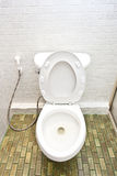 White toilet in very clean bathroom Royalty Free Stock Photos