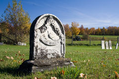 White Tombstone. A old marble tombstone with additional tombstones inthe background royalty free stock photo