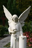 White tombstone angel on a grave Royalty Free Stock Photography