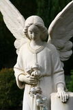 White tombstone angel on a grave Royalty Free Stock Photos
