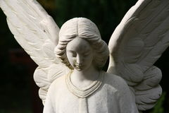 White tombstone angel on a grave Royalty Free Stock Images